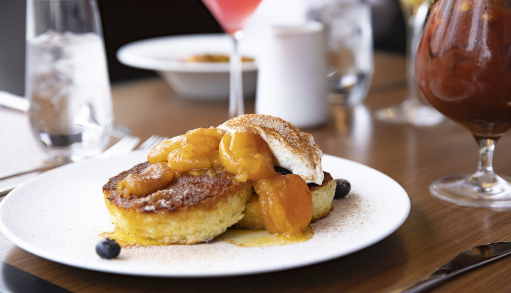 This image has an empty alt attribute; its file name is He-Said-magazine-dallas-brunch-of-the-week-flora-street-cafe-Heavy-Handed-Blueberry-Pancakes-1024x588.jpg